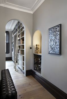 The walls are painted in London Cloud from the Damo collection, available at Sigmar. The woodwork is Cocoa, also from Damo. #Sigmar #Hallway #shelving #winestorage http://sigmarlondon.com/