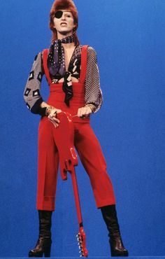 """David Bowie (wearing an eye patch) performs """"Rebel Rebel"""" on the TV show TopPop on Feb. in Hilversum, Netherlands. This was Bowie at the end of his Ziggy era. (Photo by Gijsbert Hanekroot/Redferns/Getty Images) Bowie Ziggy Stardust, David Bowie Ziggy, Tilda Swinton, Rock Chic, 70s Glam Rock, Stevie Nicks, Rolling Stones, Style Glam, David Bowie Fashion"""