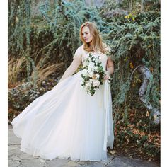 modest wedding dress with flowy skirt from alta moda.      ------              photo: tessa barton       ----------                 modest bridal gown with lace sleevees