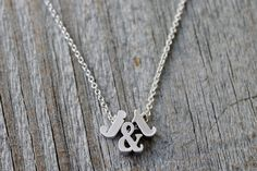 Hey, I found this really awesome Etsy listing at https://www.etsy.com/listing/190216434/tiny-silver-lowercase-initial-ampersand