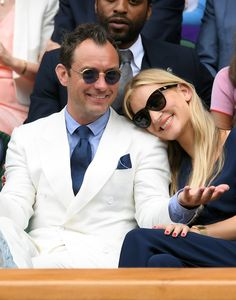 Jude Law shows us how you wear a white suit in the summertime. The light blue shirt and navy accessories keep it from looking too pristine and precious. The devil-may-care attitude helps, too.