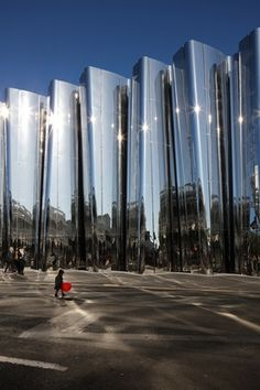 """""""A repetitive koru design is sinuously carved in concrete and explodes upwards towards the sky,"""" creating a """"draped curtain of architecture, people and sky in constant motion"""""""