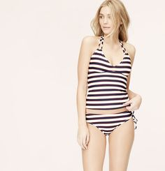 In cabana-inspired stripes, this halter style is always getaway-ready. Halter strap ties at neck. Removable soft foam cups. Lined. To give you the best possible fit, use the following list to match sizes to your cup size: XS=A, S=A/B, M=B/C, L=C, XL=C/D.