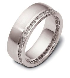 Men's wedding band in 14kt white gold with channel set diamonds by Liberty Diamonds.