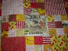 close up on my Rupert Bear quilt, featuring images from one of his Daily Mail Christmas annuals