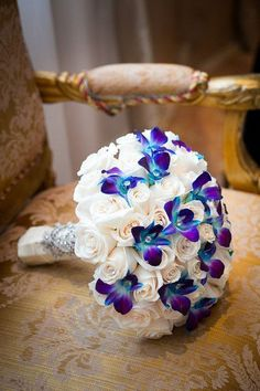 Glam purple and white wedding bouquet - white roses + purple and blue orchids {Joshua Zuckerman Photography}