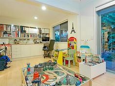 Interesting Playroom Office Ideas for christmas we surprised the girls with a new playroom we actually moved their playroom I Love The Way The Adult Stuff And Kid Stuff Shares The Space Here Playroom Ideas Pinterest The Kid Shared Office And Offices