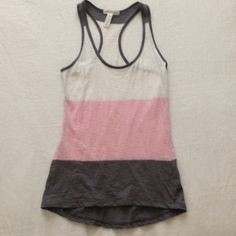 Tri Color Racerback Tank Top This tri-color racerback tank top is lightweight for the hot summer months and is great for working out or running errands. Size M-fits size S-M Tops Tank Tops