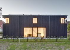 Möhring Architekten clad this holiday home in Germany in black-painted wood and cut windows out of the corners to give it a contemporary edge