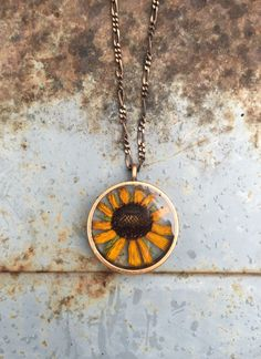 A Real Black Eyed Susan Flower Preserved in Eco Resin in Copper Pendant and Copper Chain. Botanical, Forest, Green, Nature, Love by JupiterOak on Etsy https://www.etsy.com/listing/255973508/a-real-black-eyed-susan-flower-preserved
