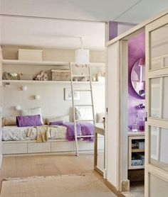 girls bedroom with walk-in closet and bathroom