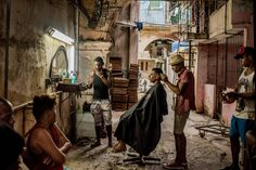 A weathered barber shop in Old Havana, Cuba by Tomas Munita [2016]