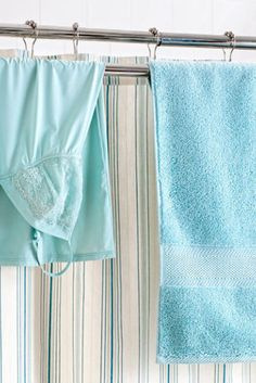 Let your towels and delicates dry — without being on display. Install an inexpensive combination shower-curtain rod and towel bar, and items can drip-dry into your tub. (We mounted ours backward, so the towels hang behind the curtain.)