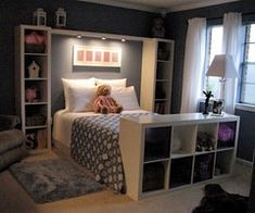 Shelving units beside the bed, & at the end of the bed.