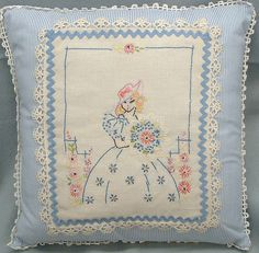 Pillow made from vintage doiley and lace on new ticking-like fabric with rick-rack.