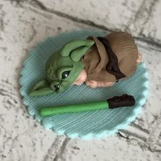 This listing is for one baby in Yoda themed outfit 2 long with light saber on a base *