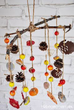 This great craft could be modified to use objects solely found in the forest and twine.  Children can gather objects then work on their sorting skills and patterns when planning their mobile.  Fine motor skills are used to create the mobile itself.  Craft suitable for all ages with parental help.  Book ideas:  Let's Count Autumn, Little Acorn Grows UP
