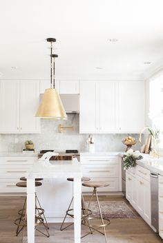 White Kitchen Gallery marble countertops white cabinets and brass fixtures- exactly what