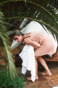 Princess Diana. I'm guessing she is attempting to hide from the paparazzi.