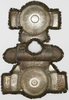 Armour of the Ottoman Empire. 16th to 17th century krug (cuirass/chest armor) with Saint-Irene Arsenal mark, complete with cotton fringes, worn by fully armored cavalryman in conjunction with migfer (helmet), dizcek (cuisse or knee and thigh armor), zirah (mail shirt), kolluk/bazu band (vambrace/arm guards), and kolçak (greaves or shin armor).