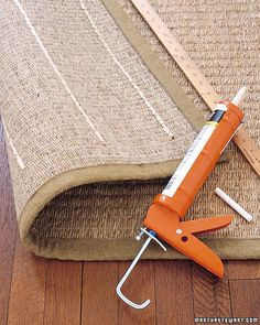 To give an area rug some traction, flip it over, and apply lines of acrylic-latex caulk every 6 inches or so. Once dry, you can safely put down your rug; the rubbery strips will hold it in place.