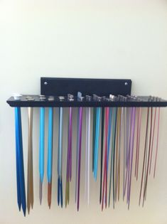 Knitting needle rack.  old shelf I got at the thrift store,  drill 2 each of all different size holes in it, then spray painted it . Instant knitting needle rack.