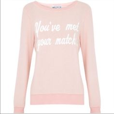 Wildfox 'You've met Your Match...' Size L Pre-Loved but in great shape, Wildfox Couture baggy beach jumper 'You've Met Your Match...' Size Large. Color looks like a nude/pink/light peach color (to me) no cracks in the white lettering as you can see from the photos. Please ask any questions you may have before purchasing     ✨No Trades/PP✨ Wildfox Sweaters