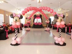 Dance floor balloon arches with Minnie Mouse twisted balloon columns. Great for kids party.