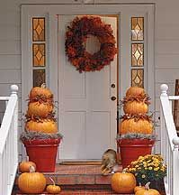 I love this front porch.  I'm going to have to try out those pumpkin topiaries!