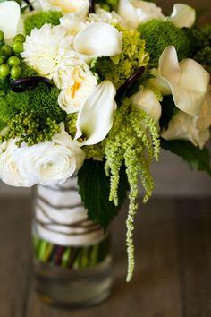 Mini calla lilies, ranunculus, roses, dahlias, hypericum, fiddlehead ferns, amaranthus