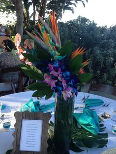 The other side of the table arrangements for a tropical beach wedding. Flowers by Travis Payne