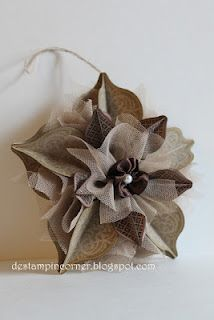 ribbon flower -- follow links through to see tutorial on making ribbon flower with pearl center -- could be nice on napkins