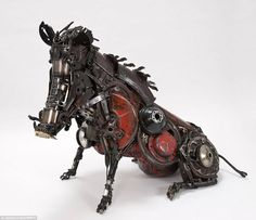 Sculptures Made From Old Car Parts by James Corbett.