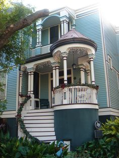 Light Blue Queen Anne Victorian Home w/ White trim and Turreted porch detail - Galveston Island, Texas   c. 1895