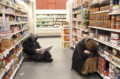 Tami Chappell/Reuters STUCK: People rested in the aisle of a Publix grocery store Wednesday in Atlanta after being stranded by a snowstorm. A rare winter storm gripped the U.S. South on Wednesday, killing five people, stranding children overnight at their schools, snarling traffic across many states and canceling flights.