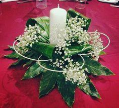 Centro de mesa con velas.
