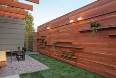 Modern Wall Lamp For Modern Wood Fence Design Using Green Plants On The Fence. Contemporary home fencing and gates for modern wood fance design. Tricks for Using Modern Wood Fence Designs. Modern Wood Fence, Wood Fence Design, Modern Fence Design, Modern Front Yard, Front Yard Fence, Wooden Fence, Cedar Fence, Wooden Gates, Concrete Fence