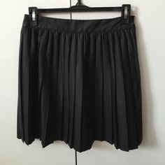 Sparkle and fade Pleated pleather skirt Bout from urban outfitters, brand new, never worn. Zipper closure Sparkle & Fade Skirts