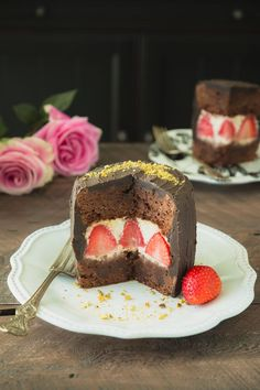 Strawberries & Cream Brownie Cake - A creamy mascarpone filling with strawberries is sandwiched between brownie layers, then slathered with a heavenly black cocoa buttercream frosting.  Click for recipe.
