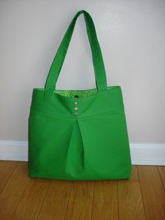 Sale-Green pleated and sparkle button bag. $36.00, via Etsy. A fun green bag!