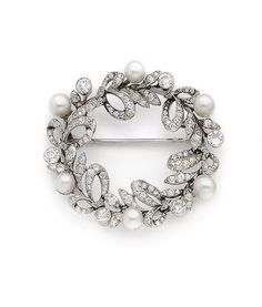 A natural pearl and diamond wreath brooch,