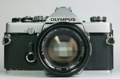 my first camera - Olympus OM-1 (STILL have it, matter of fact...lenses too!)