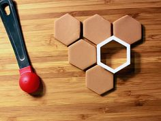 Honeycomb Cookie Cutter. Undeniable proof that I'm a whack job: I don't do roll out cookies because the waste involved bothers me. I'd get these though.