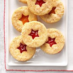 Raspberry Linzer Cookies Recipe -These wonderful cookies require a bit of extra effort to make and assemble, but the delight on the faces of family and friends when I serve them makes it all worthwhile. —Schelby Thompson, Camden Wyoming, Delaware