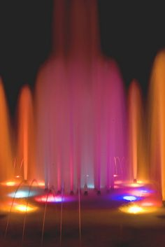 lit up pink by Natalie.Ann.Photography, via Flickr | light + light painting + fountains water night  + pink orange blue purple
