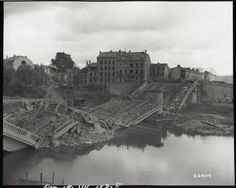 US Army Preparing to Construct a Bailey Bridge Across the Marne River in Chalons, France9/8/1944. Note the soldiers on the bridge and the equipment on the far bank. (US National Archives)