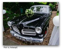 wedding car with flowers and balloons