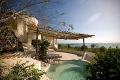 african luxury vacation villa couldn't have more of a beautiful backyard. Vacation Villas, Dream Vacations, Outdoor Spaces, Outdoor Living, Outdoor Ideas, Beautiful Homes, Beautiful Places, Infinity Pool, Adobe House