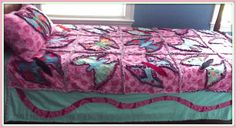 pink and aqua butterfly rag quilt, twin, designer fabric, flannel, matching pillow sham. $225.00, via Etsy.