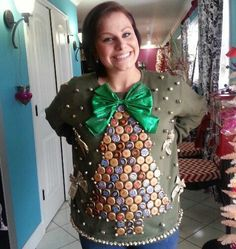 Before you throw away the toppers to your cream soda or bubbly beer, consider stashing them away for this DIY project. Simply glue the bottle caps in a tree formation to an old sweater and top it off with a big, fancy bow. Voila! Source: Pinterest.  - WomansDay.com